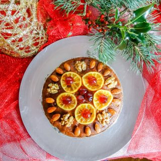 Fruit cake on silver plate with holly