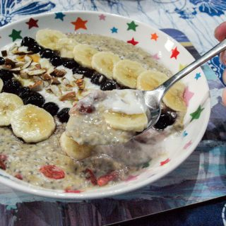 Delicious superfood porridge with Manuka Honey and blueberry compote