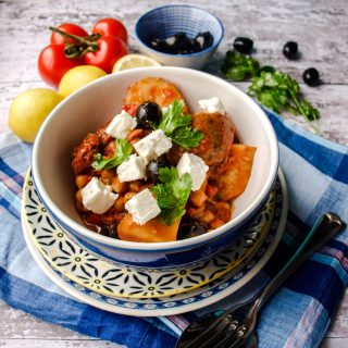 Bowl of Slow Cooker Greek Baker's Pot with olives and tomatoes