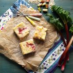 Oaty Rhubarb Cheesecake Bars: Creamy Cheesecake with tart rhubarb on a crispy oat base #cheesecake #rhubarb #oats #bars