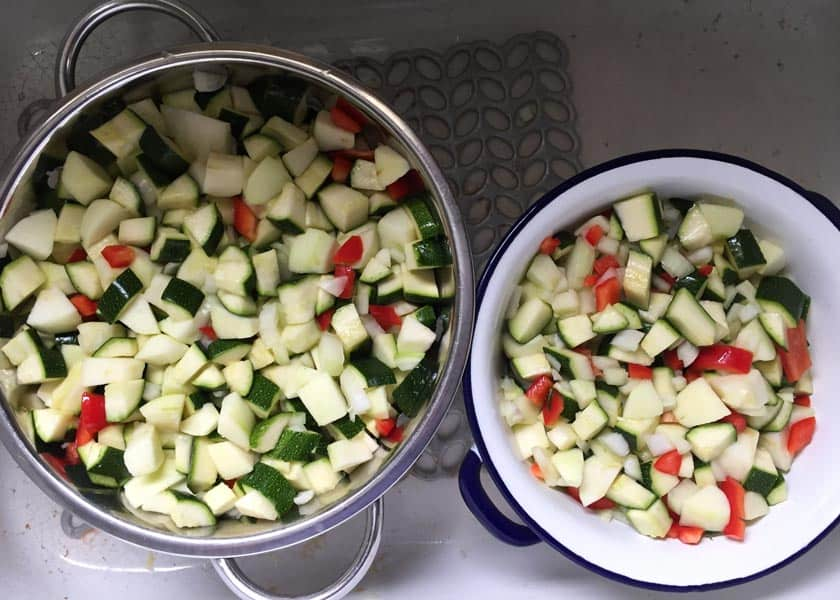 Drain off the excess liquid from the vegetables for Spicy Courgette and Apple Chutney