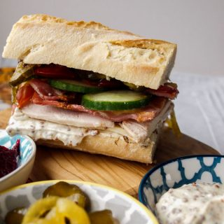 Serve The Best Leftover Turkey Club Sub Sandwich with more mustard mayo, and pickles