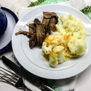 Plate of beef, mashed potatoes and cualiflower cheese