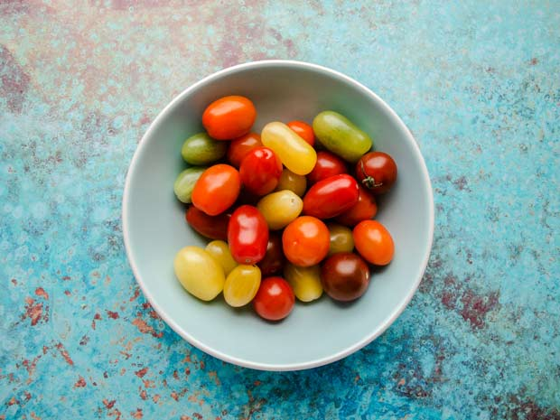 bowl of coloured cherry and grape tomatoes